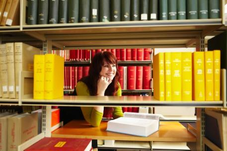 A student using journals in the library
